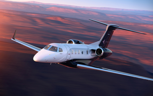 Embraer Phenom 300 in flight